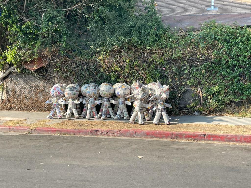 One dozen unpainted piñatas